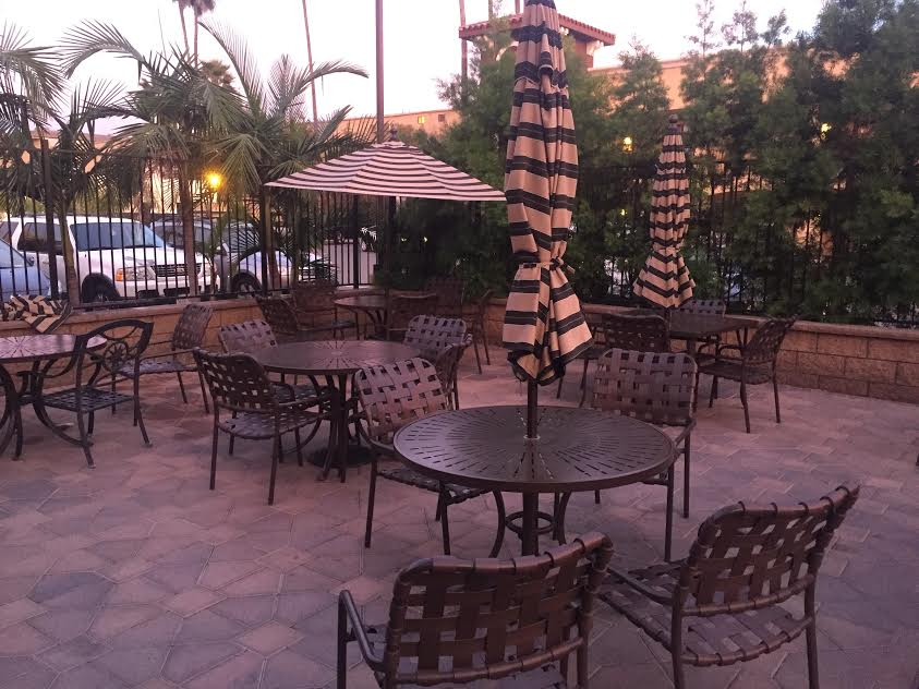 Grand Legacy At The Park pool seating. A Disneyland area hotel.