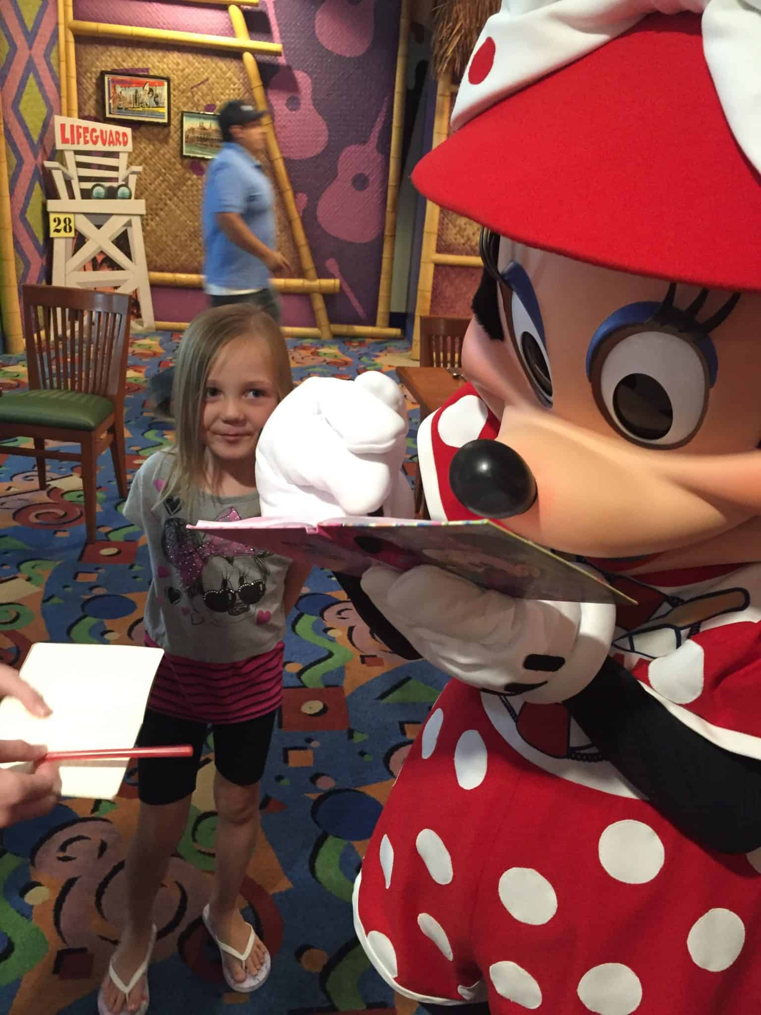 Minnie Mouse signs autograph.