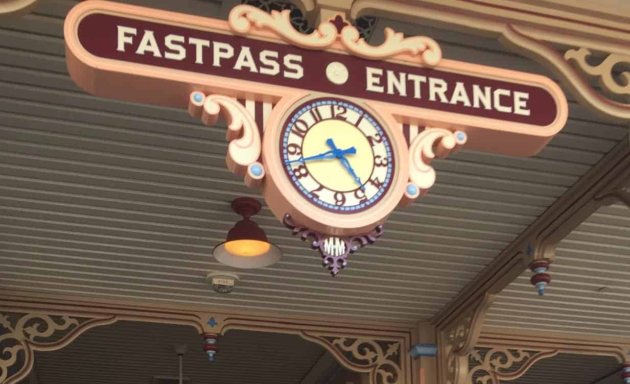 Toy Story Midway Mania FASTPASS entrance with clock overhead.