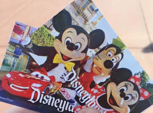 Two Disneyland tickets featuring Mickey Mouse, Goofy, Minnie Mouse and Lighting McQueen.