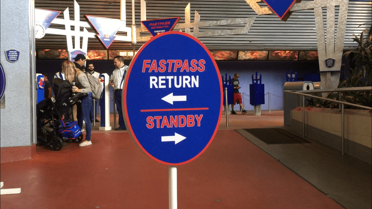 Space Mountain FASTPASS return line and standby sign at Disneyland.