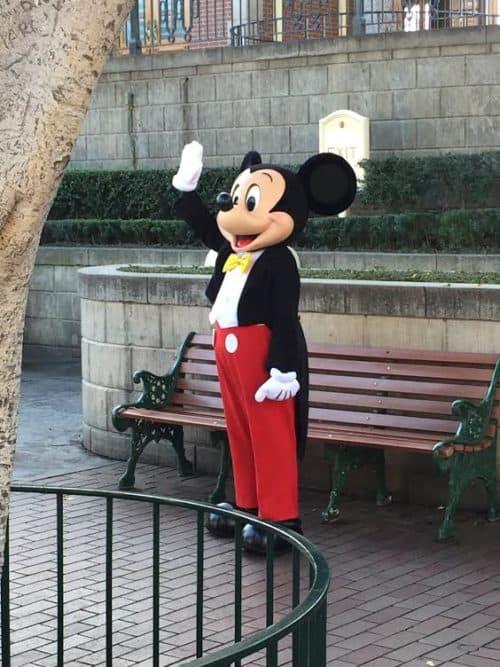 Mickey waves hello